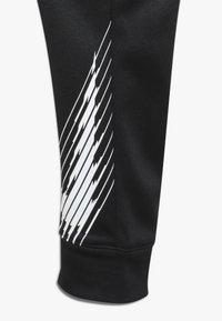 Nike Performance - THERMA PANT - Pantaloni sportivi - black/white - 2
