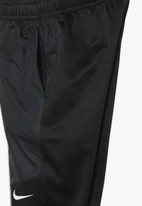 Nike Performance - THERMA PANT WINTERIZED - Spodnie treningowe - black - 3