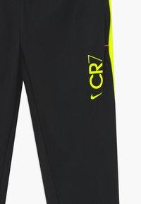 Nike Performance - DRY - Tracksuit bottoms - black/lemon - 2