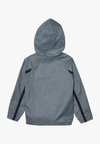 Nike Performance - SPORT WOVEN - Veste coupe-vent - smoke grey/black - 1