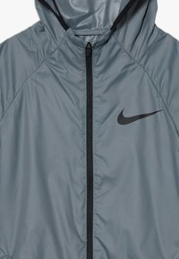 Nike Performance - SPORT WOVEN - Veste coupe-vent - smoke grey/black - 4