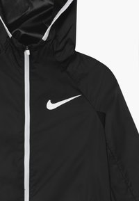 Nike Performance - SPORT WOVEN - Veste coupe-vent - black/white