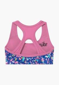 Nike Performance - REVERSIBLE - Sports bra - hyper blue/magic flamingo - 1