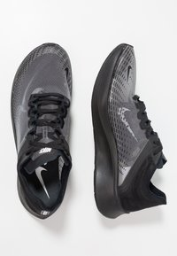 Nike Performance - ZOOM FLY SP - Competition running shoes - black - 1