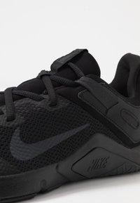 Nike Performance - LEGEND ESSENTIAL - Sports shoes - black/white - 5