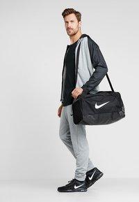 Nike Performance - Sports bag - black - 1