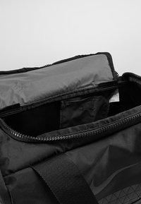 Nike Performance - JET DRUM MINI - Sports bag - black/black/black - 4