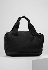 Nike Performance - JET DRUM MINI - Sports bag - black/black/black - 2