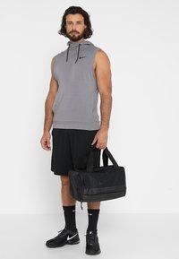 Nike Performance - JET DRUM MINI - Sports bag - black/black/black - 1
