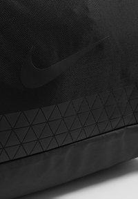 Nike Performance - JET DRUM MINI - Sports bag - black/black/black - 8