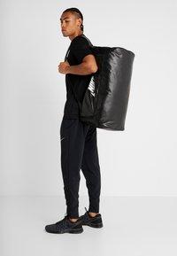 Nike Performance - DUFF - Sports bag - black/white - 1