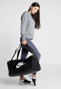 Nike Performance - DUFF - Sports bag - black/white - 6