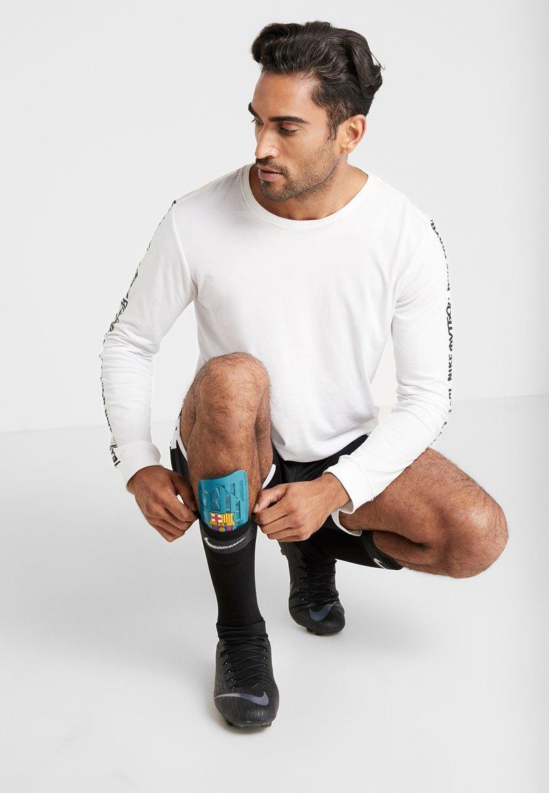 Nike Performance - FC BARCELONA MERC  - Shin pads - cabana/deep royal