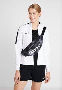 Nike Performance - HIP PACK - Bältesväska - black/white - 7