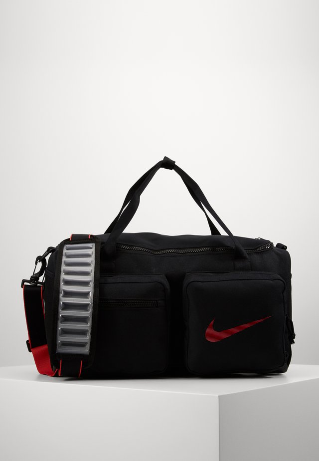 UTILITY S DUFF - Sports bag - black/track red