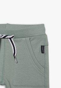 Noppies - PANTS SLIM AMES BABY - Trousers - green milieu - 4