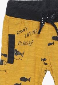 Noppies - REGULAR FIT PANTS ASHWAUBENON  - Trousers - mineral yellow - 3