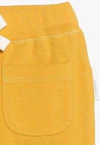 Noppies - TROUSERS RELAXED QUAQUA BABY - Legging - mineral yellow - 2