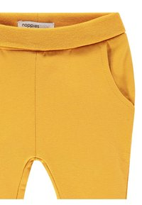 Noppies - HUMPLE - Tracksuit bottoms - honey yellow - 2