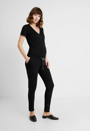 NURS BANU - Jumpsuit - black