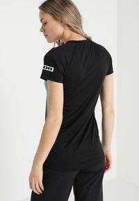 ION - TEE LETTERS SCRUB  - T-Shirt print - sea green - 2