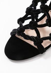 N°21 - Heeled mules - black - 2