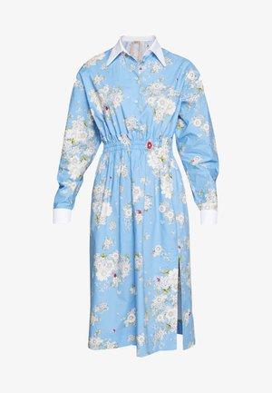 Korte jurk - fantasia base azzurra