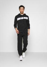 N°21 - Pantalon de survêtement - black - 1