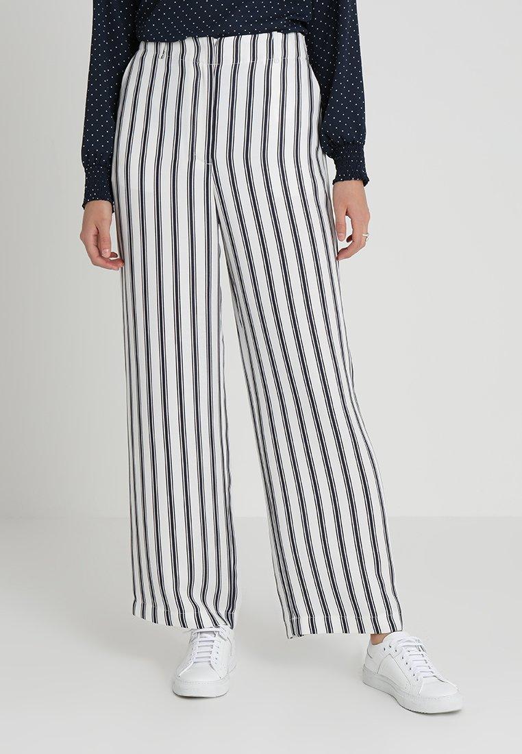 NAF NAF - ERAYINE  - Pantaloni - noir/blanc