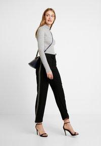 NAF NAF - EJOGA - Trousers - noir - 2