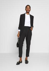 NAF NAF - EPIPA  - Pantalones - noir - 1