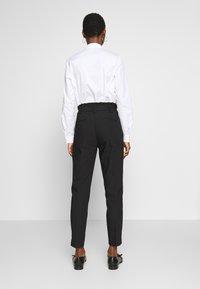 NAF NAF - EPIPA  - Pantalones - noir - 2