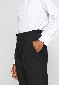 NAF NAF - EPIPA  - Pantalones - noir - 5
