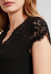 NAF NAF - HELENE - Basic T-shirt - noir - 6