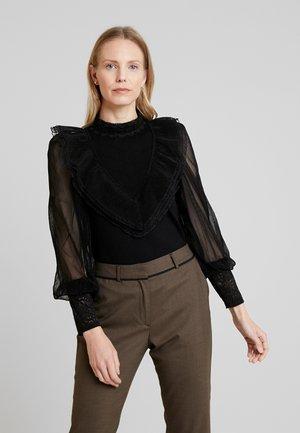 Stickad tröja - noir