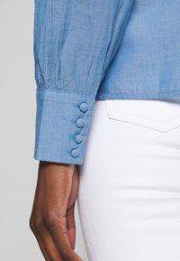 NAF NAF - CHAMBRE - Button-down blouse - light blue - 6