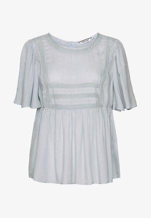 TOURNIS - Bluse - bleach