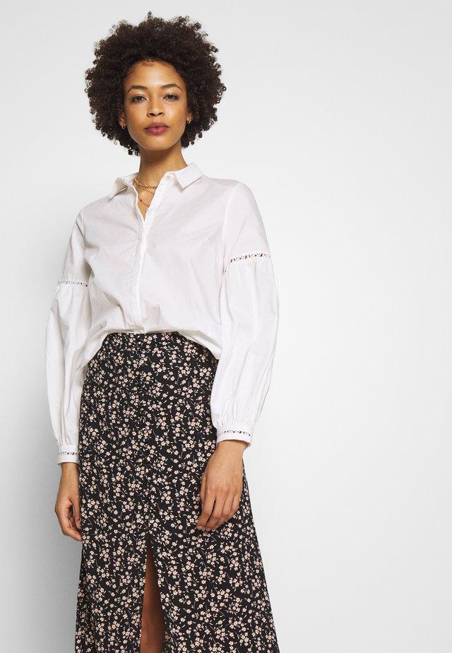 AMORINETTE  - Button-down blouse - ecru