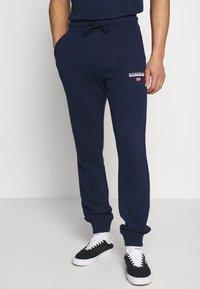 Napapijri - MERT - Spodnie treningowe - medieval blue - 0