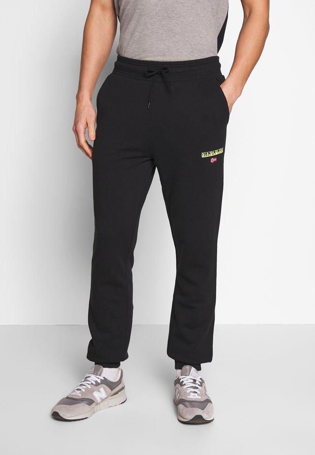 MERT - Pantalones deportivos - black