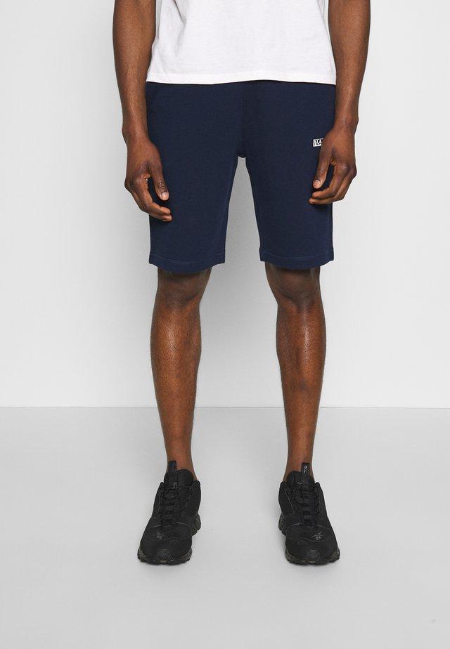 NERT - Spodnie treningowe - medieval blue