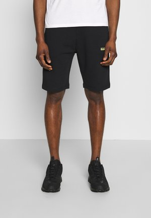 NERT - Tracksuit bottoms - black