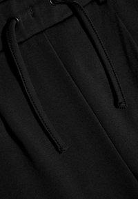 Name it - NKFLORNELIA IDA  - Trousers - black - 2