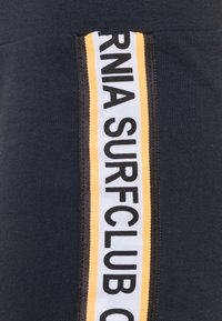Name it - NKMHELMHEAD SET - Pantaloni sportivi - orange pop - 3