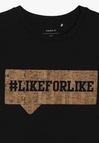 Name it - NKMKAKKAN - Triko spotiskem - black - 4