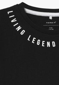 Name it - NKMBONAS - T-shirt med print - black - 3