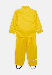 Name it - NKNDRY RAIN SET - Rain trousers - empire yellow - 2