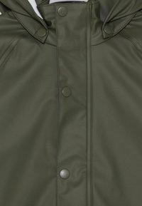 Name it - NKNDRY RAIN SET - Kalhoty do deště - thyme - 6