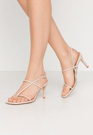 STRAPPY STILETTO - High heeled sandals - nude