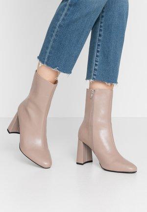 ANGULAR HEEL BOOTIES - High heeled ankle boots - taupe
